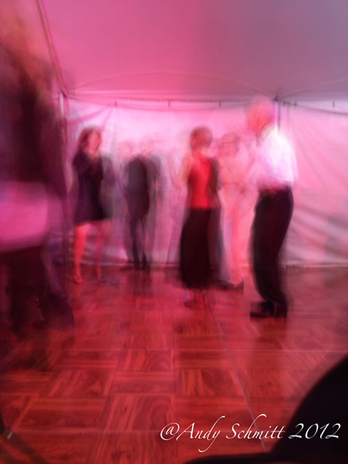 Group of fashionably dressed people slow dancing